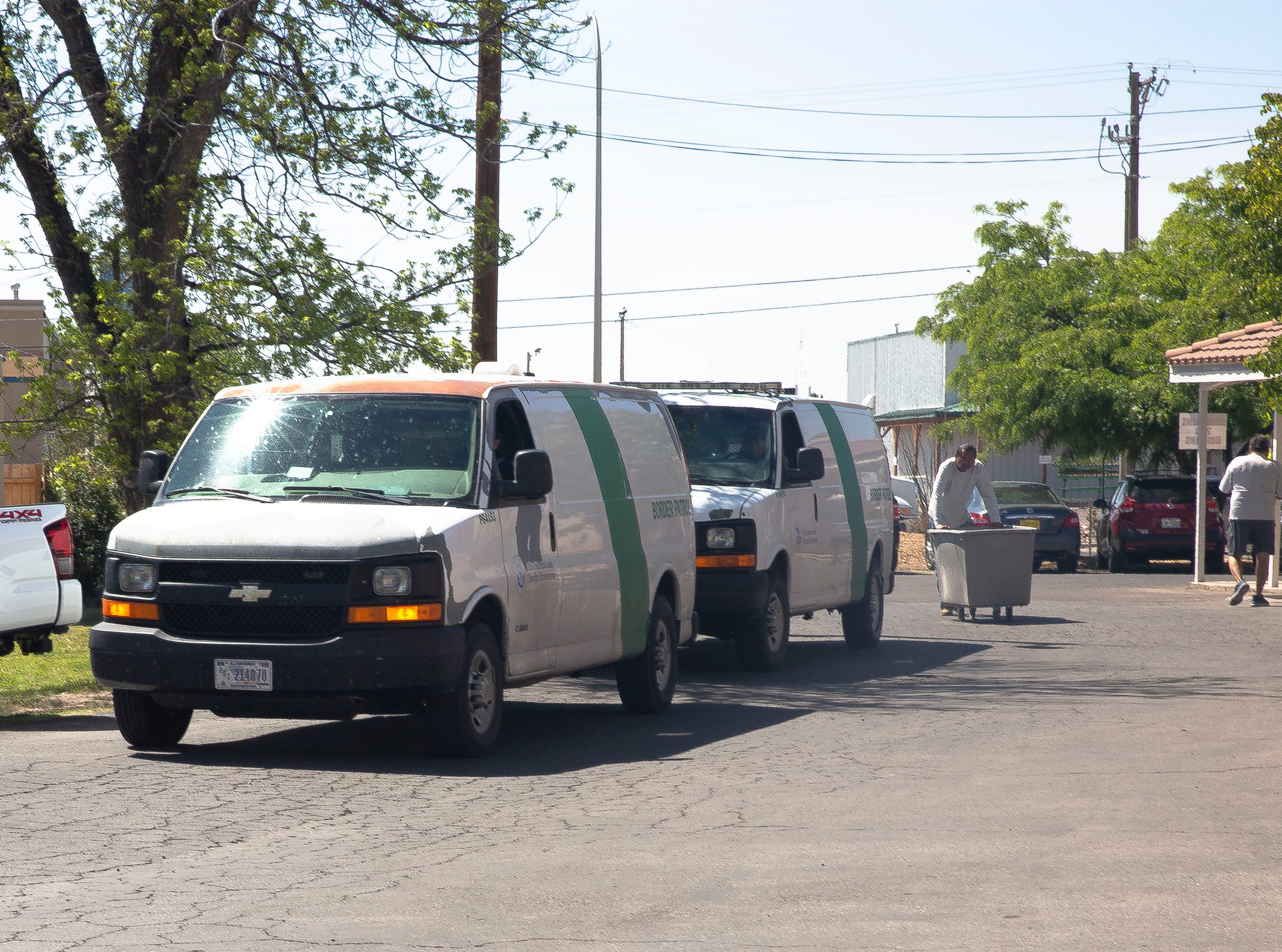 Border Patrol vans arrive Monday, April 15, 2019, at the Gospel Rescue Mission in Las Cruces. The mission received about 170 migrants on Monday.