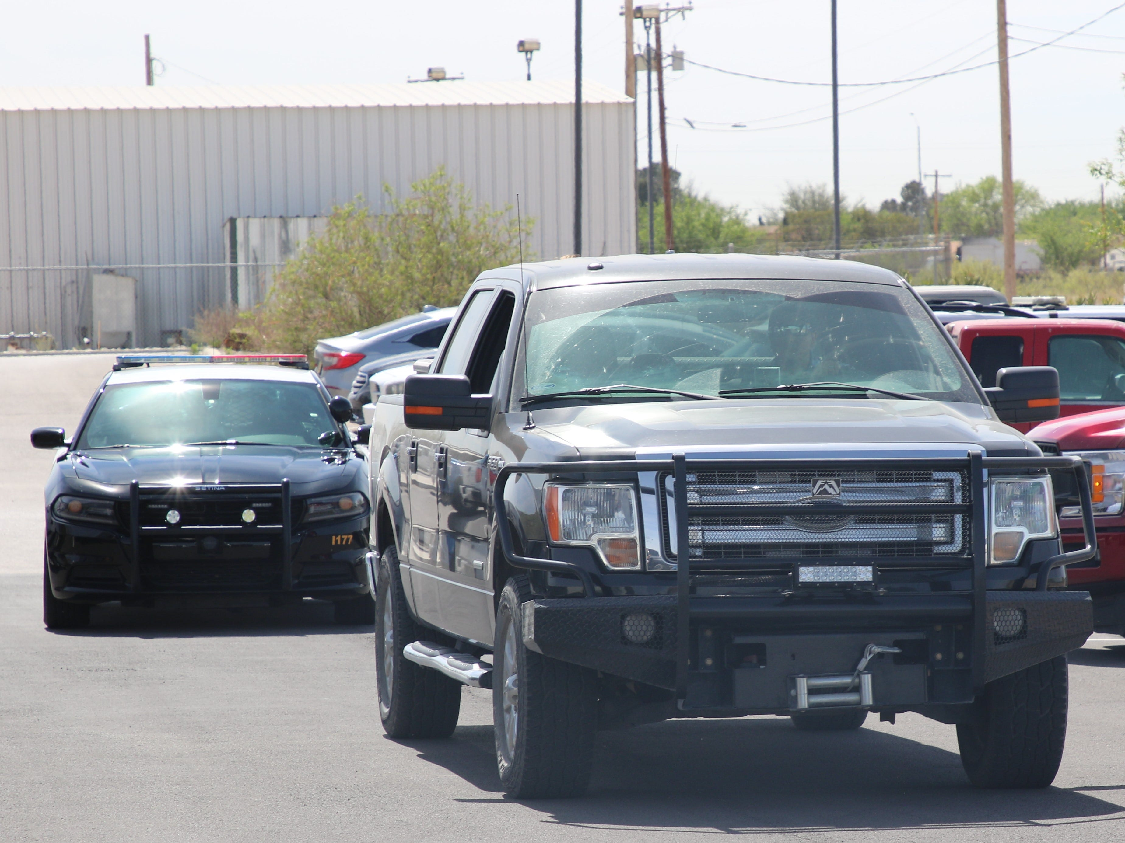 Eddy County Sheriff's deputy Alexander Duchene is pursued by Adrian Rodriguez and Roman Leos April 15 at the Eddy County Sheriff's Office in Carlsbad.