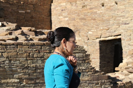 U.S. Rep. Deb Haaland, D-NM, walks along a wall at Pueblo Bonito, Sunday, April 14, 2019, at Chaco Culture National Historical Park.