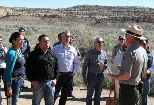 From left, Rep. Deb Haaland and Rep. Ben Ray Lujan, Aztec Mayor Victor Snover and Rep. Alan Lowenthal listen to Chaco Culture National Historical Park Chief of Interpretation Nathan Hatfield, Sunday, April 14, 2019, during a tour of Pueblo Bonito at Chaco Culture National Historical Park.