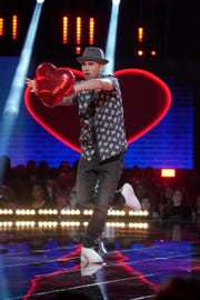 """John Austin competes Sunday on NBC's """"World of Dance"""" show during a performance he dedicated to his wife."""