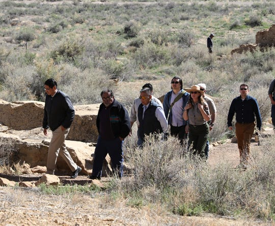At front, Navajo Nation President Jonathan Nez and U.S. Rep. Raul Grijalva, D-Ariz.,  walk along the Pueblo Bonito trail, Sunday, April 14, 2019, at Chaco Culture National Historical Park.