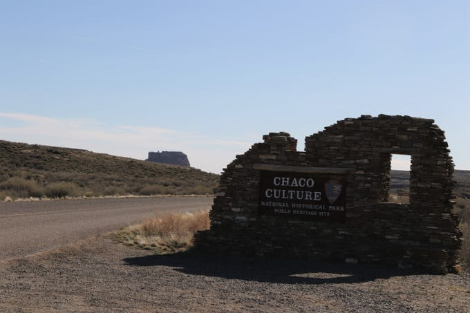 The entrance sign to Chaco Culture National Historical Park is pictured, Sunday, April 14, 2019, with Fajada Butte in the background.