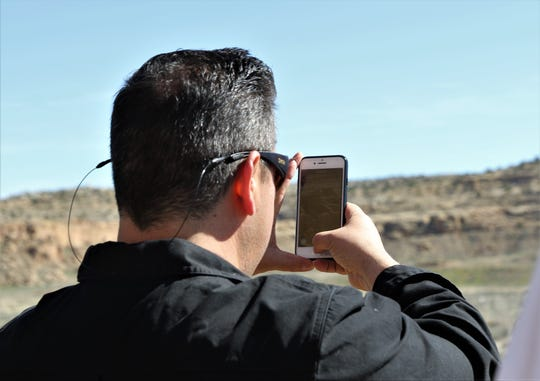 U.S. Rep. Ben Ray Lujan takes a picture of Pueblo Bonito, Sunday, April 14, 2019,  during a tour of Chaco Culture National Historical Park.