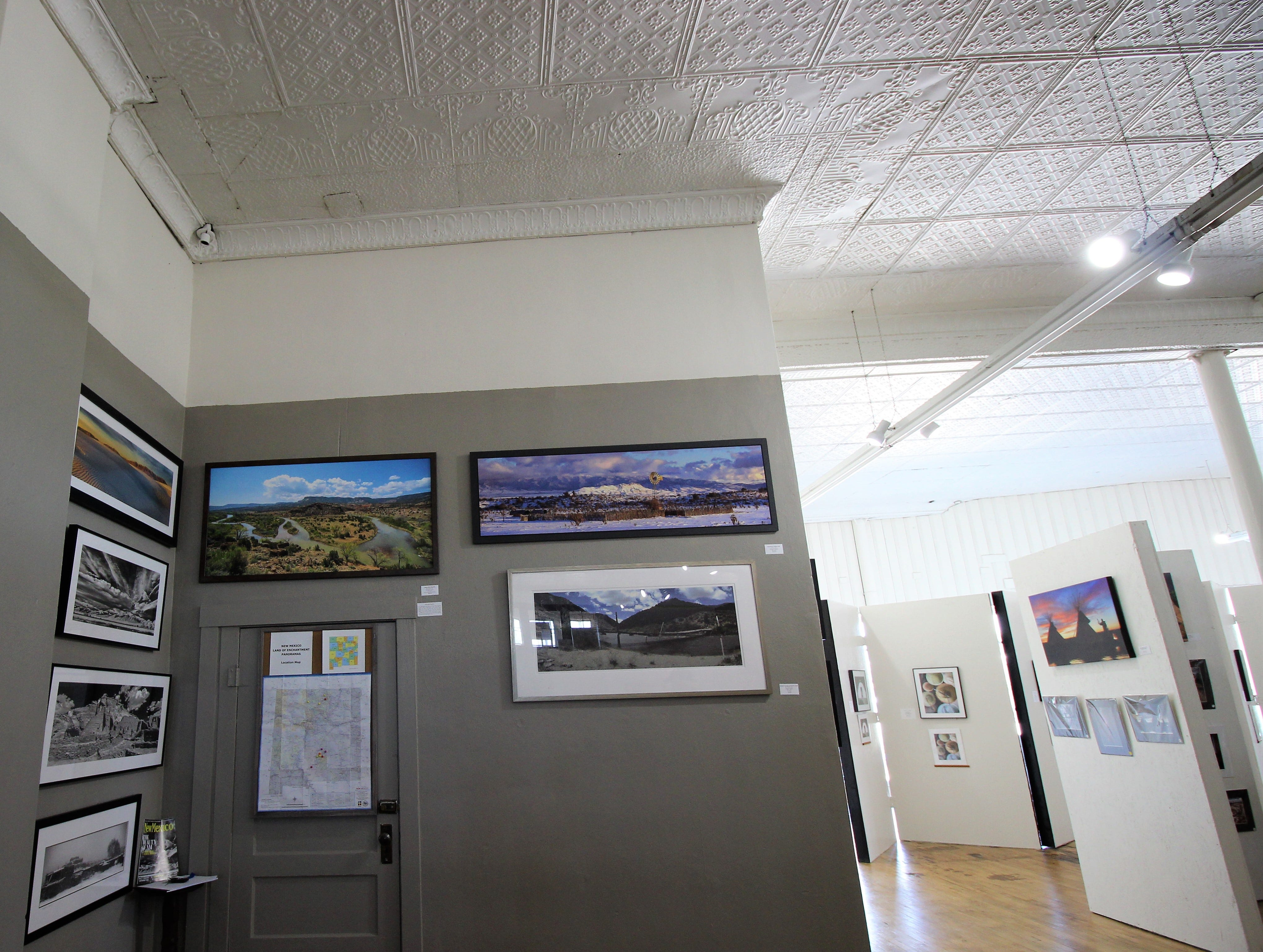 Photographers from all over New Mexico have their work on exhibit at the Tularosa Basin Gallery of Photography. A map has been placed on the wall and photographers mark where they are from with a push pin.