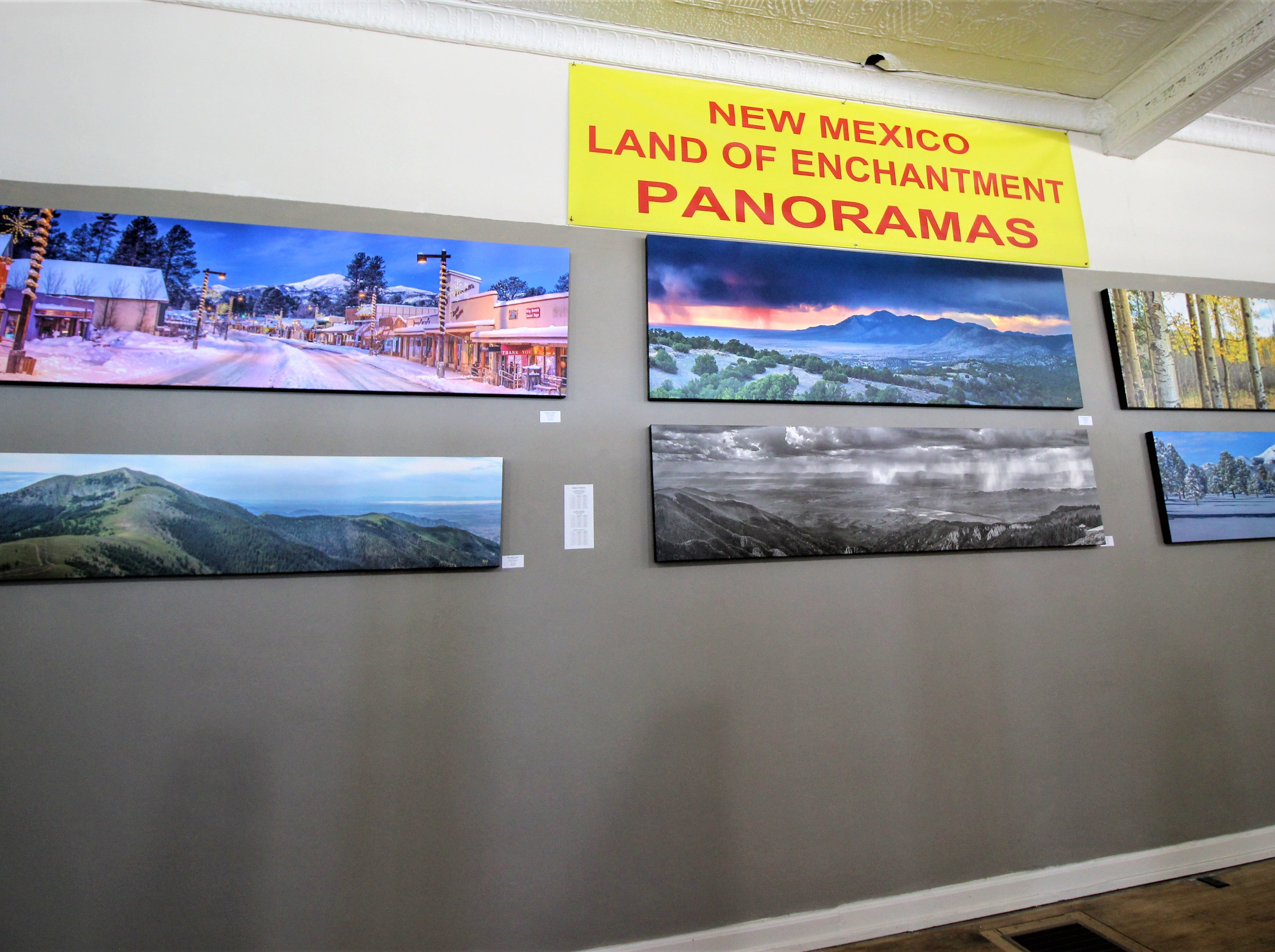 A 70' wall displays panoramic photography. The exhibit opened on April 13 and will be adding more photographs. Some of the paintings are over 6' in length containing several panels.