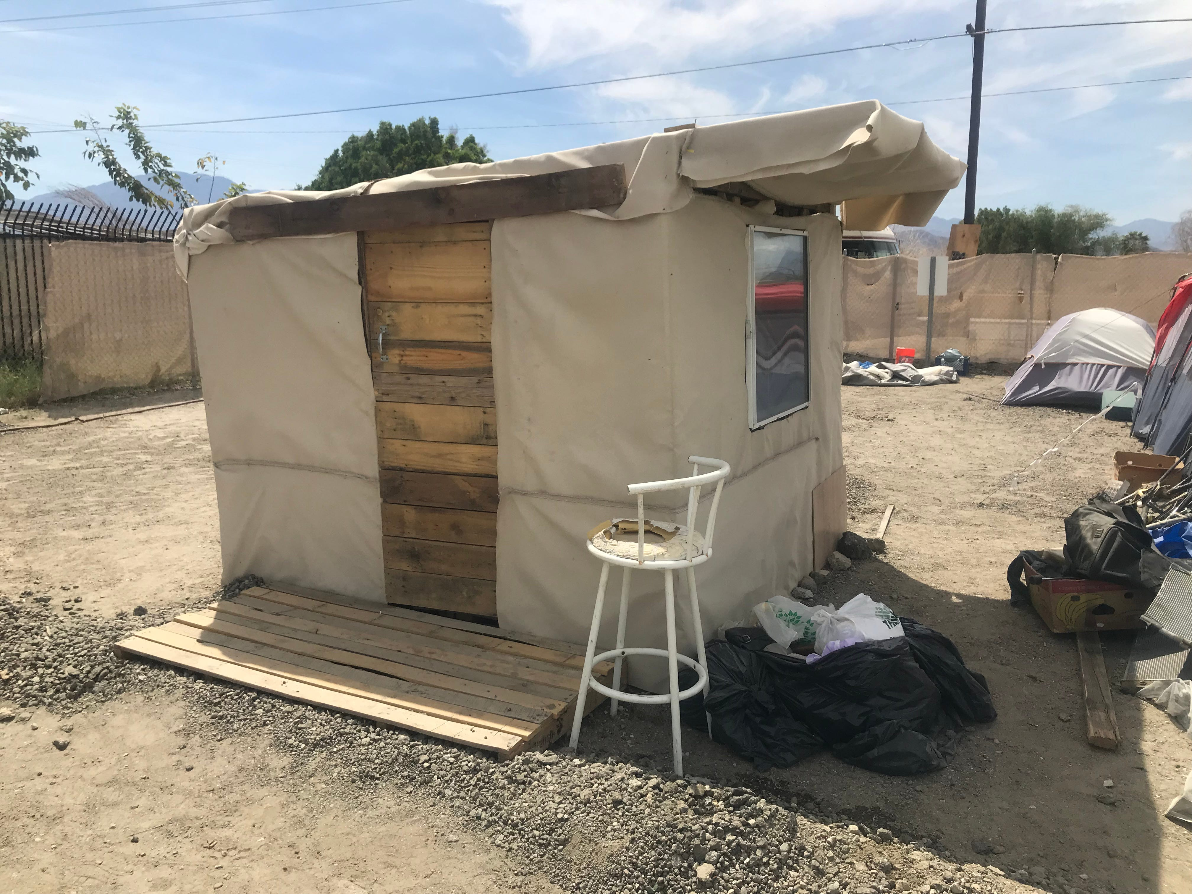 In the past few weeks, residents helped to build a hut, complete with a window, at the One Stop Shoppe encampment.