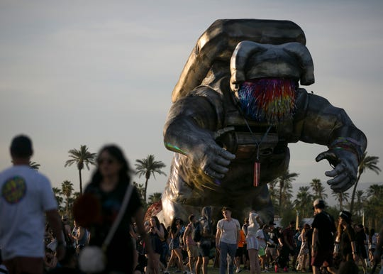 """Overview Effect,"" by the art collective that created the Astronaut for the 2014 Coachella, wheels his way around the current Coachella Valley Music and Arts Festival returning to Indio Friday."
