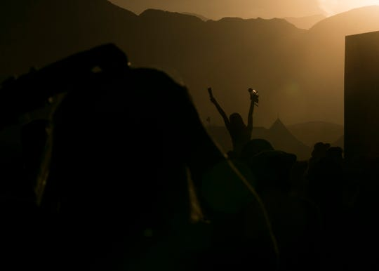 The sun sets over the Coachella Valley Music and Arts Festival in Indio, Calif., on Sunday, April 14, 2019.