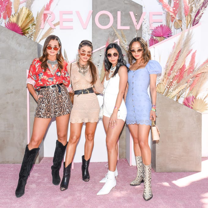 Danielle Bernstein, Camila Coelho, Raissa Gerona and Aimee Song attend #RevolveFestival during the first weekend of the Coachella Valley Music and Arts Festival 2019.