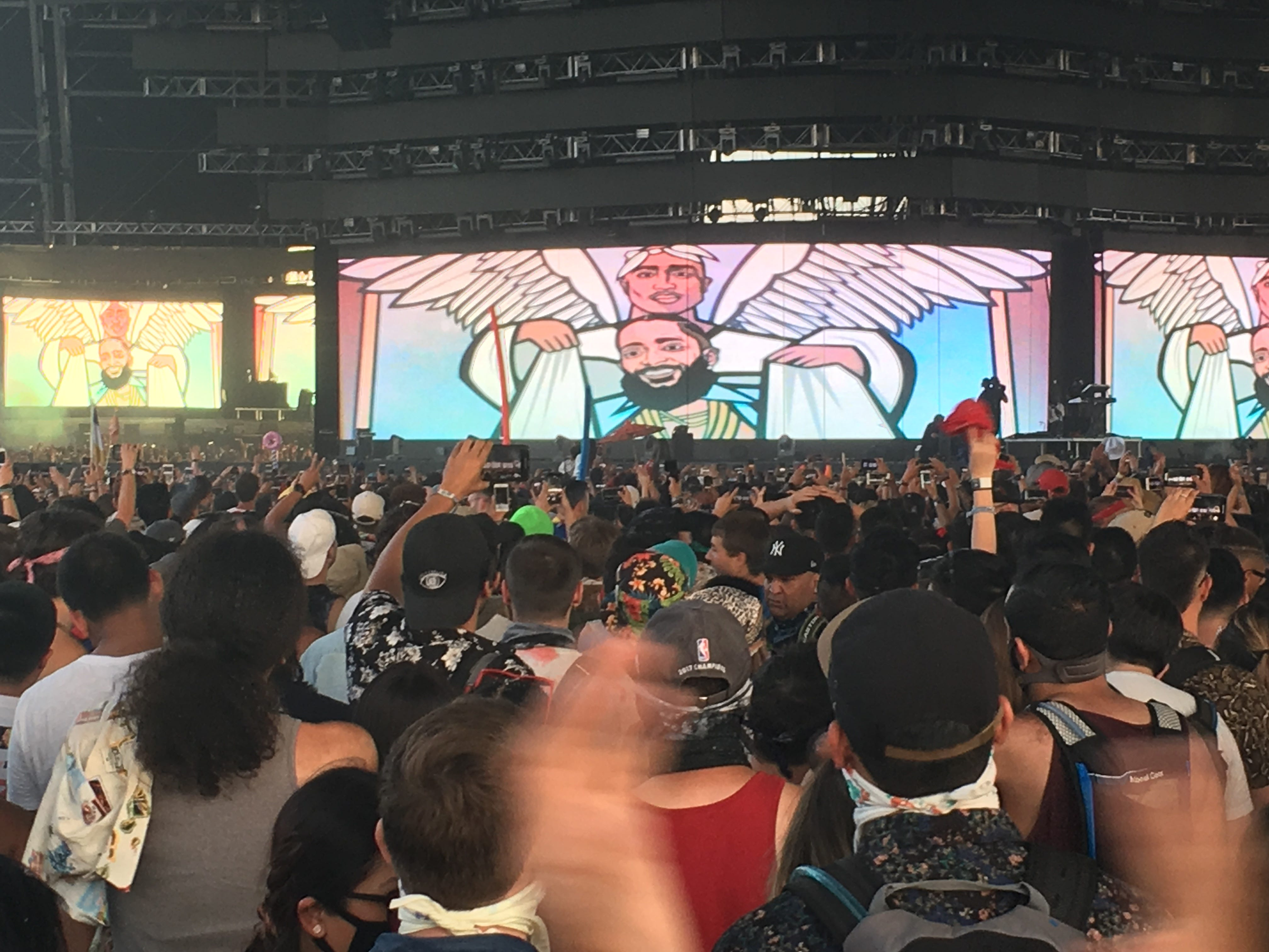During the YG show at Coachella on Sunday, an image of Nipsey Hussle floating up to heaven and being greeted there by Tupac, was shown on the big screen.