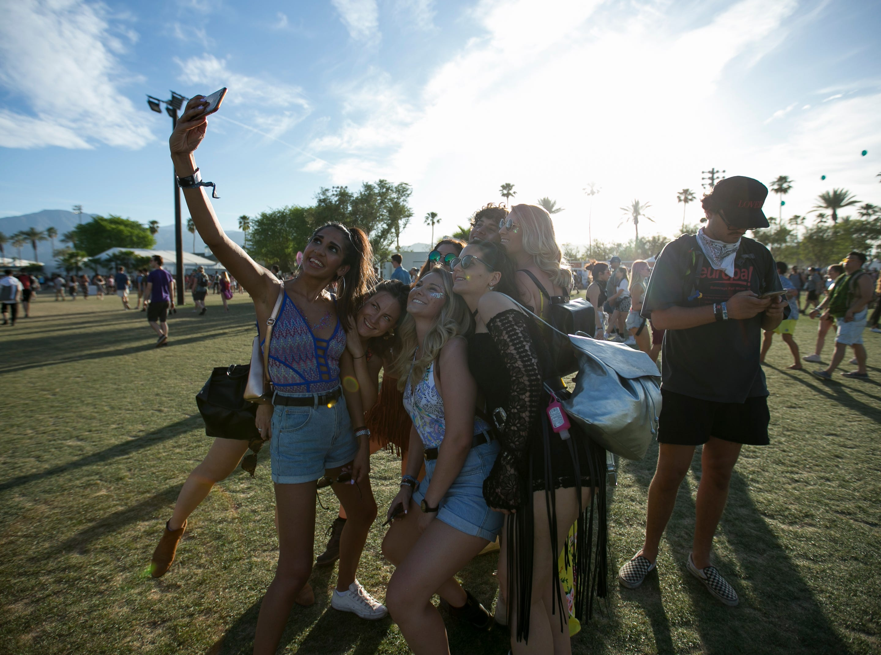 Festival goers pose for a selfie at the Coachella Valley Music and Arts Festival in Indio, Calif., on Sunday, April 14, 2019.