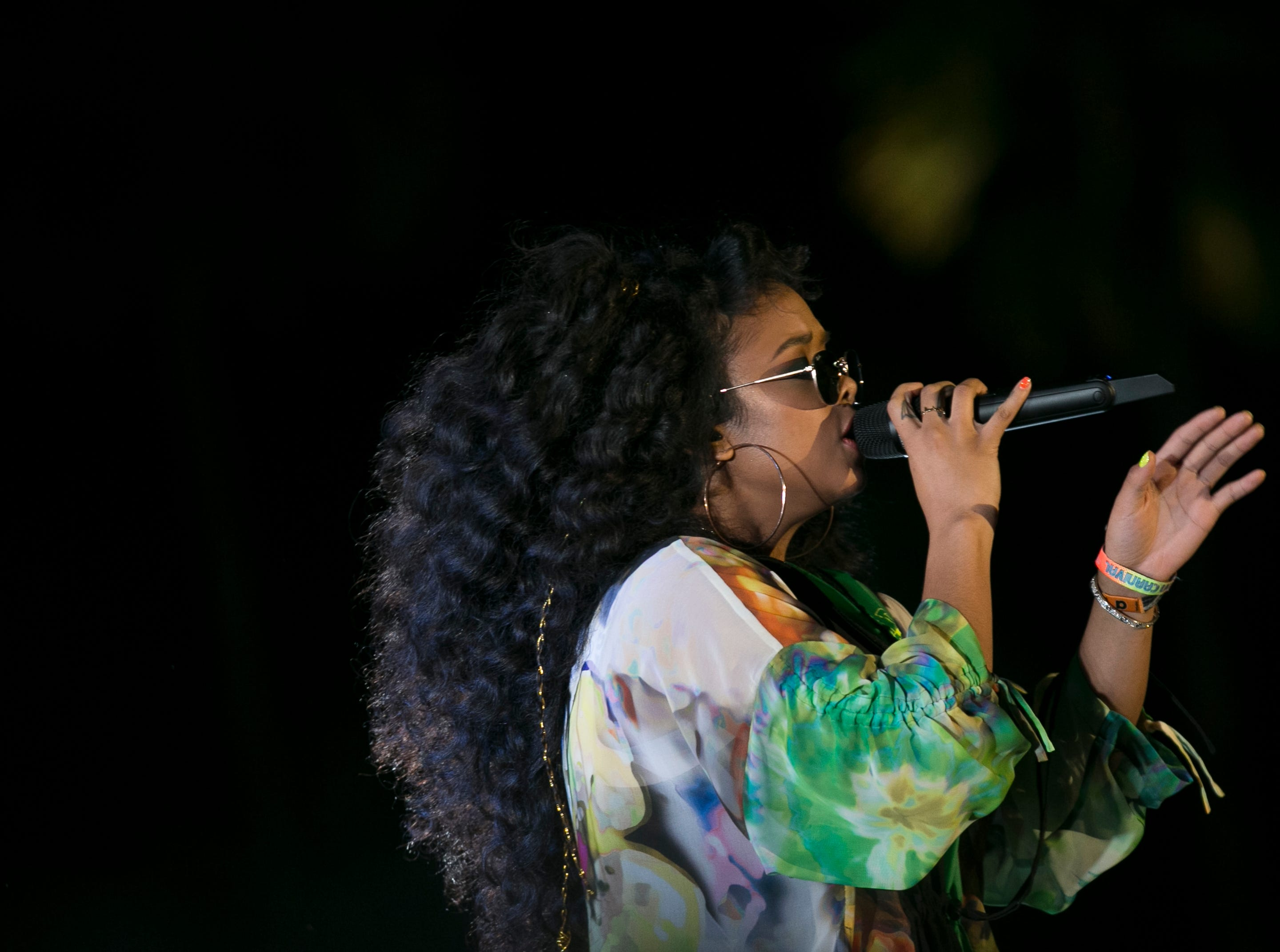 H.E.R performs on the Outdoor stage at the Coachella Valley Music and Arts Festival in Indio, Calif., on Sunday, April 14, 2019.