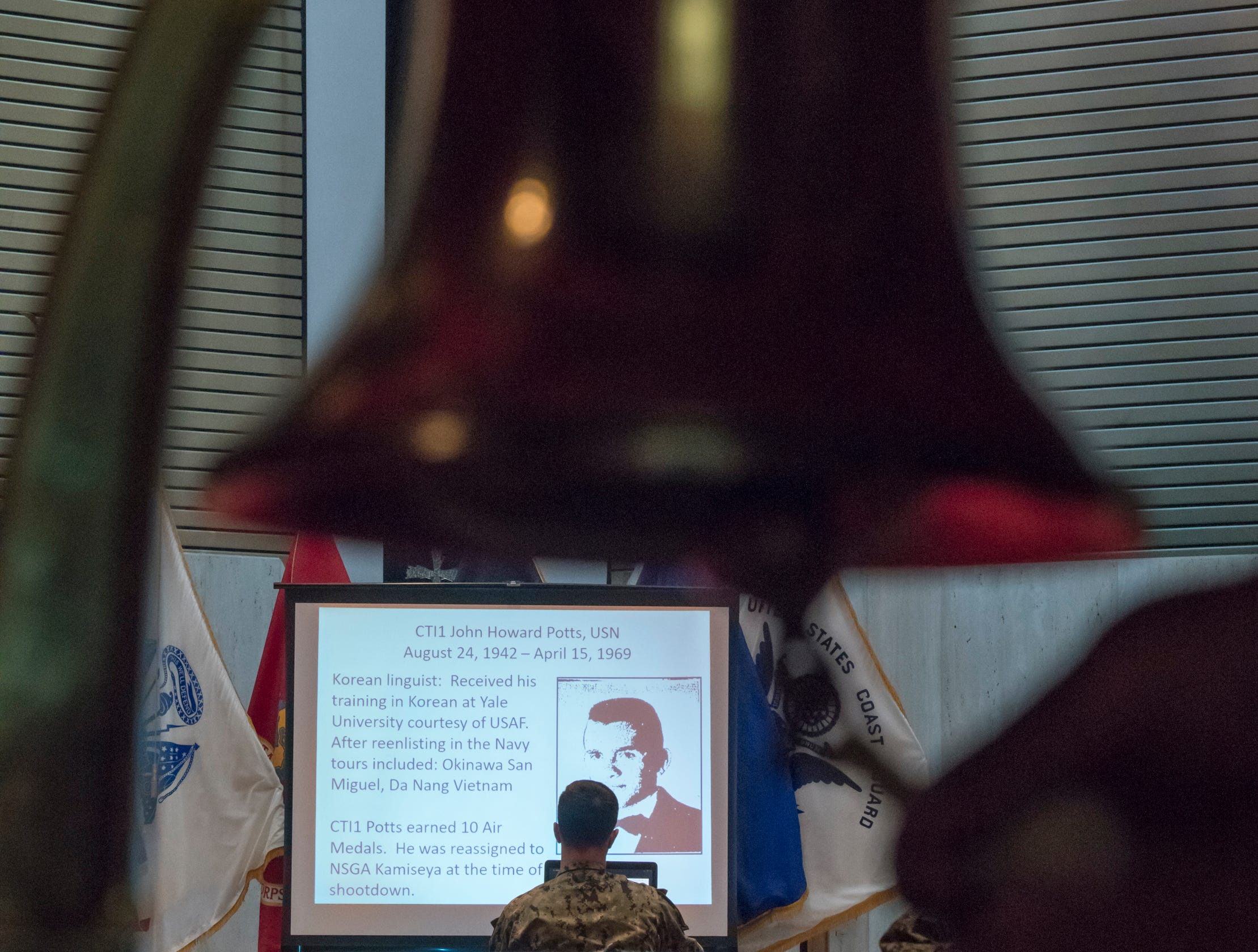 """A bell is rung as Seaman Mercedes Molina reads the names of the fallen crew of the EC-121M """"Beggar Shadow"""" reconnaissance plane during a memorial service at Corry Station in Pensacola on Monday, April 15, 2019.  The Navy EC-121M reconnaissance aircraft (PR-21/BuNo 135749) of Fleet Air Reconnaissance Squadron One (VQ-1) was shot down over the Sea of Japan by North Korea on Monday, April 14,1969.  All 31 crewmembers were killed, including nine NAVSECGRU cryptologists."""