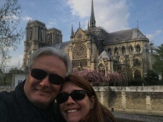 Anthony Louisiana and his wife, Santhe, pose in front of the Notre-Dame Cathedral on the day before it was engulfed in flames.