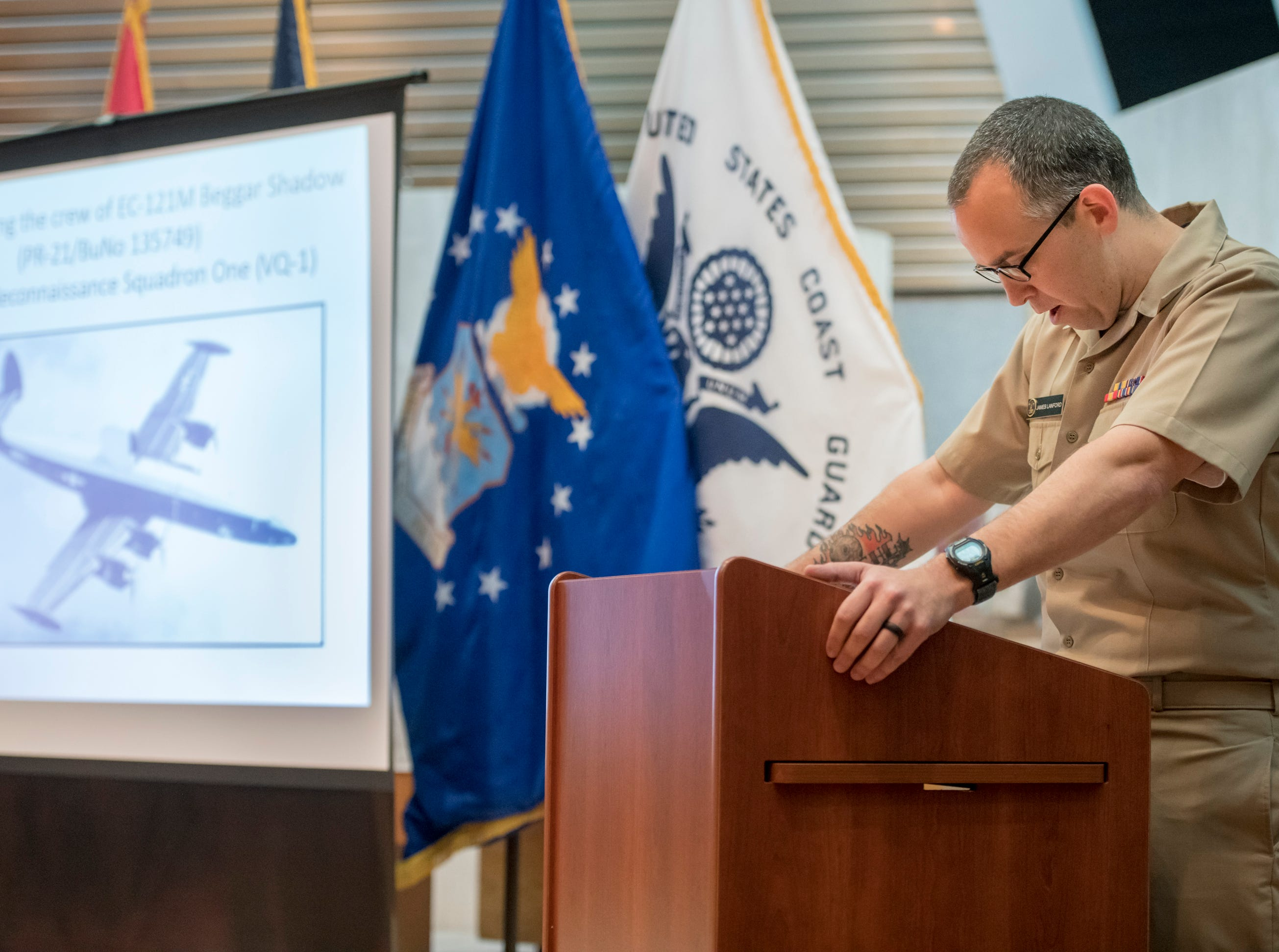 """Chaplain James Lanford gives the invocation during a memorial service for the fallen crew of the EC-121M """"Beggar Shadow"""" reconnaissance plane at Corry Station in Pensacola on Monday, April 15, 2019.  The Navy EC-121M reconnaissance aircraft (PR-21/BuNo 135749) of Fleet Air Reconnaissance Squadron One (VQ-1) was shot down over the Sea of Japan by North Korea on Monday, April 14,1969.  All 31 crewmembers were killed, including nine NAVSECGRU cryptologists."""