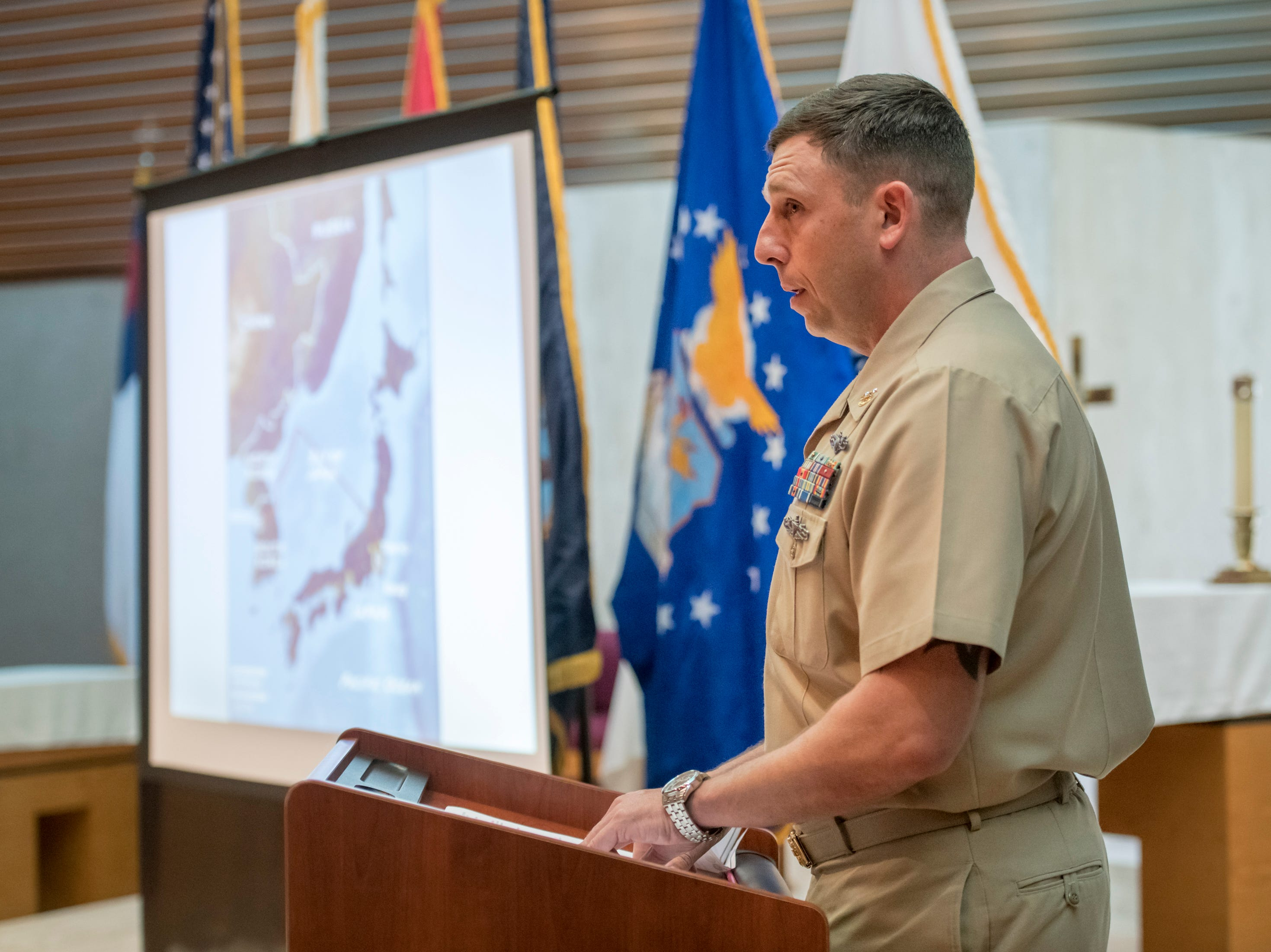 """Master Chief Seth Lambert speaks during a memorial service for the fallen crew of the EC-121M """"Beggar Shadow"""" reconnaissance plane at Corry Station in Pensacola on Monday, April 15, 2019.  The Navy EC-121M reconnaissance aircraft (PR-21/BuNo 135749) of Fleet Air Reconnaissance Squadron One (VQ-1) was shot down over the Sea of Japan by North Korea on Monday, April 14,1969.  All 31 crewmembers were killed, including nine NAVSECGRU cryptologists."""