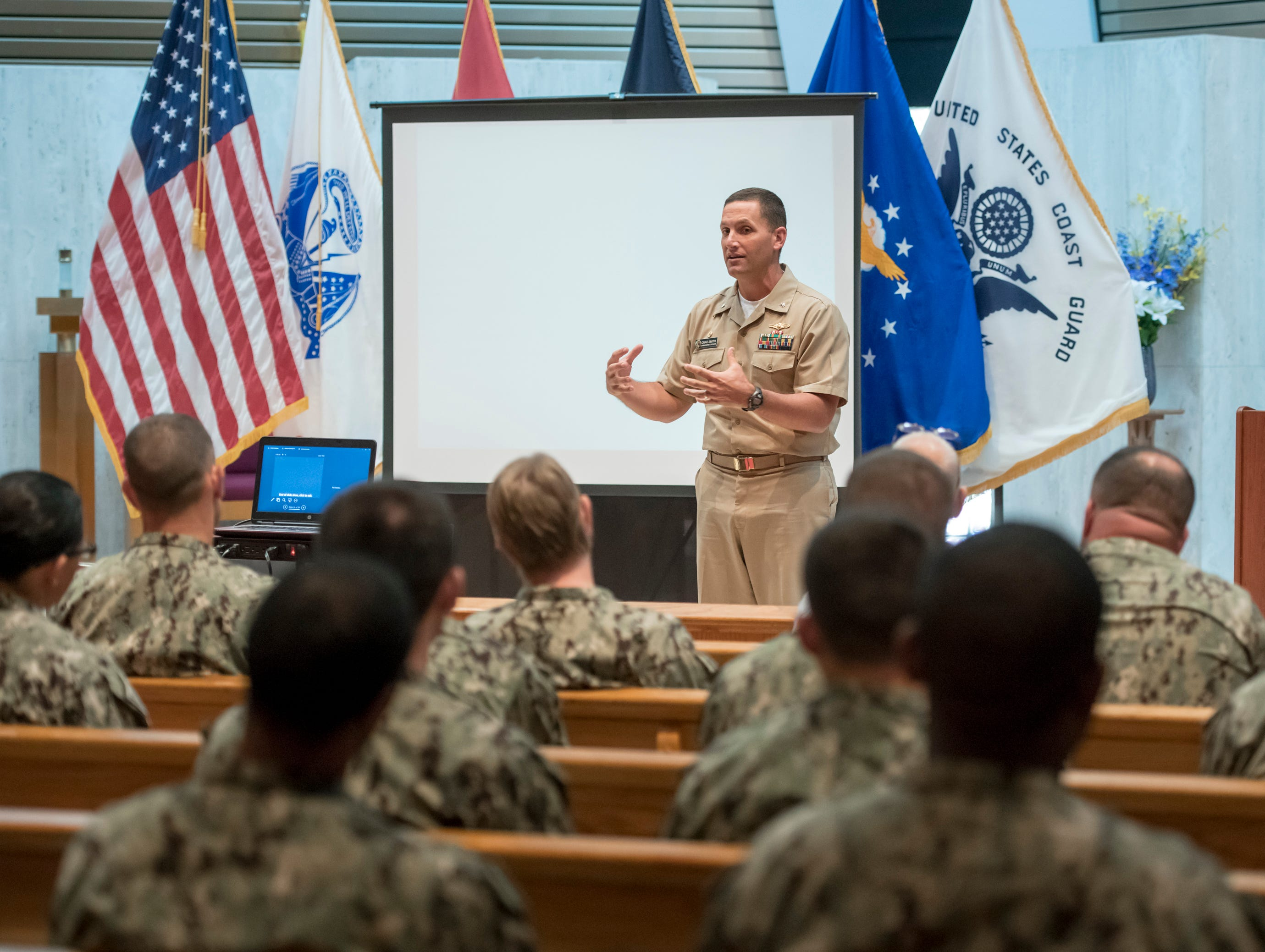 """Cmdr. Chad Smith, commanding officer Information Warfare Training Command Corry Station, speaks during a memorial service for the fallen crew of the EC-121M """"Beggar Shadow"""" reconnaissance plane at Corry Station in Pensacola on Monday, April 15, 2019.  The Navy EC-121M reconnaissance aircraft (PR-21/BuNo 135749) of Fleet Air Reconnaissance Squadron One (VQ-1) was shot down over the Sea of Japan by North Korea on Monday, April 14,1969.  All 31 crewmembers were killed, including nine NAVSECGRU cryptologists."""