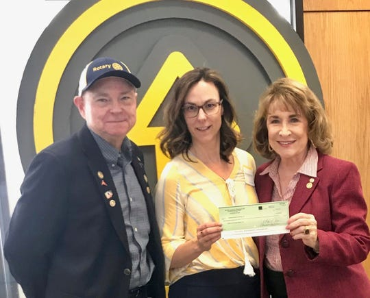Rotarian Randal Ray, district grant director, Shannon Nickinson, director of Early Learning Studer Community Institute, and Betty Roberts, president, Rotary Club of Pensacola.