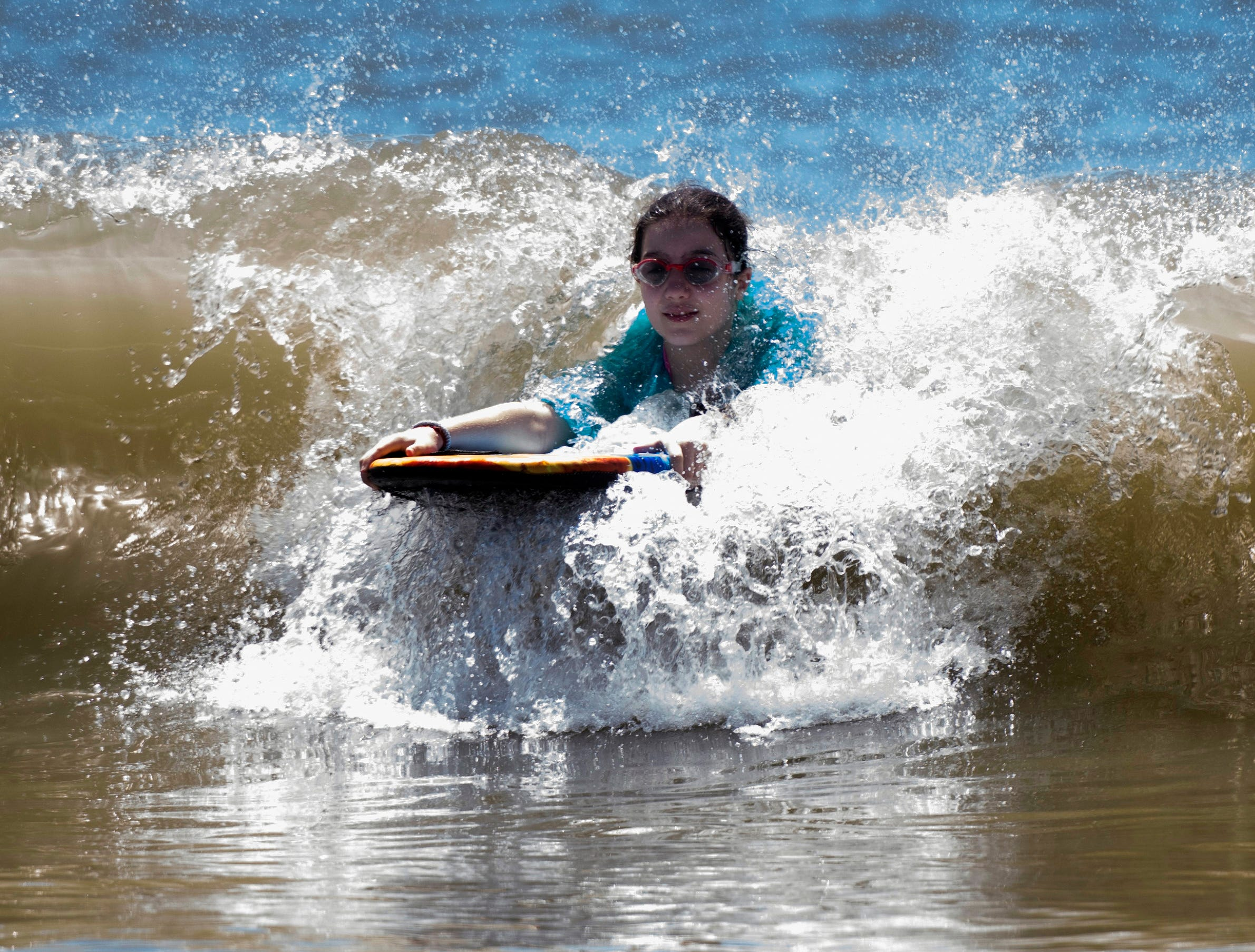 Sara Murphy spends the day frolicking in the surf on Pensacola Beach while visiting with her family while the area for spring break on Monday, April 15, 2019.