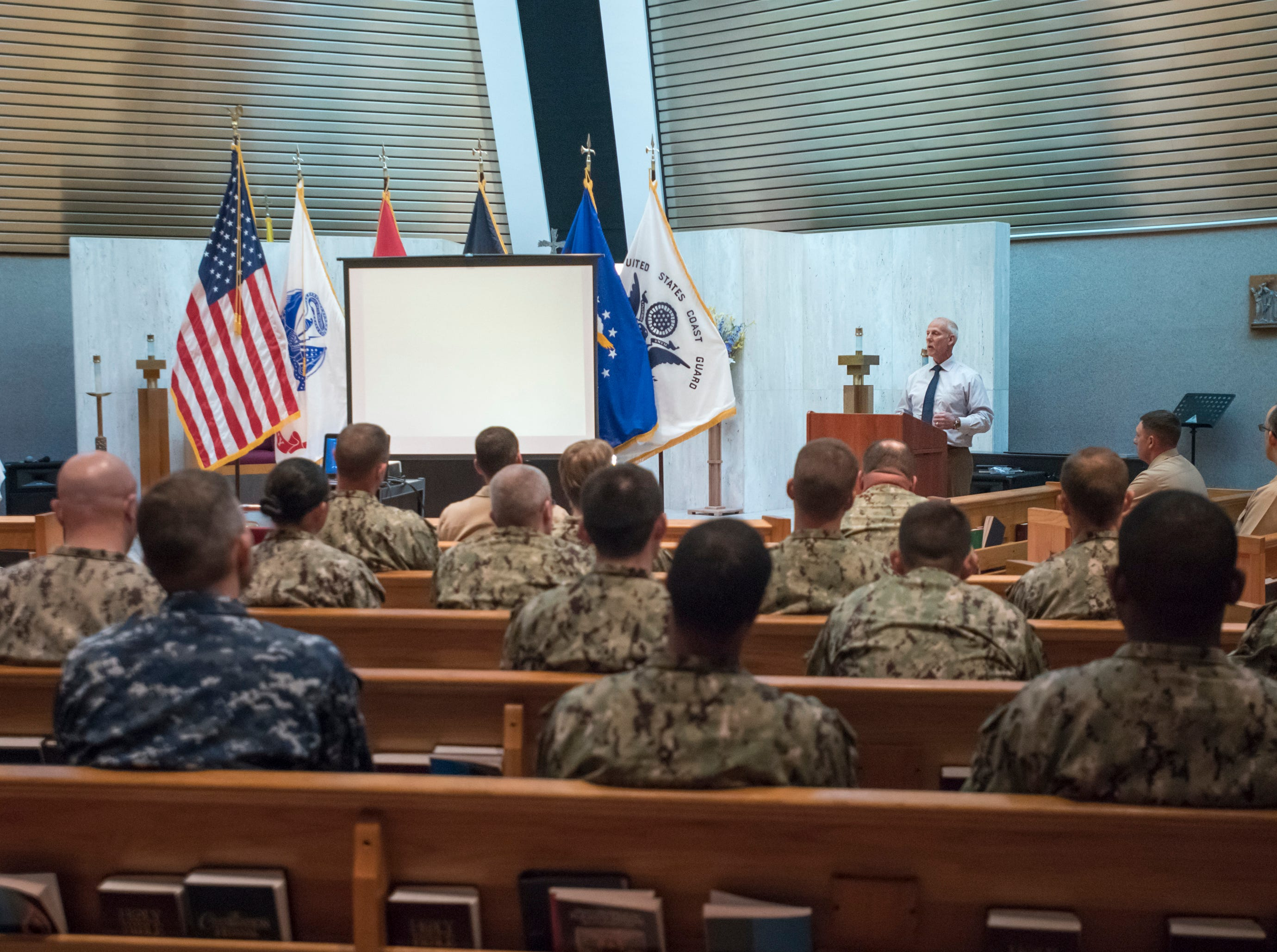 """Cryptologic warfare officer basic course instructor Mario Vulcano speaks during a memorial service for the fallen crew of the EC-121M """"Beggar Shadow"""" reconnaissance plane at Corry Station in Pensacola on Monday, April 15, 2019.  The Navy EC-121M reconnaissance aircraft (PR-21/BuNo 135749) of Fleet Air Reconnaissance Squadron One (VQ-1) was shot down over the Sea of Japan by North Korea on Monday, April 14,1969.  All 31 crewmembers were killed, including nine NAVSECGRU cryptologists."""