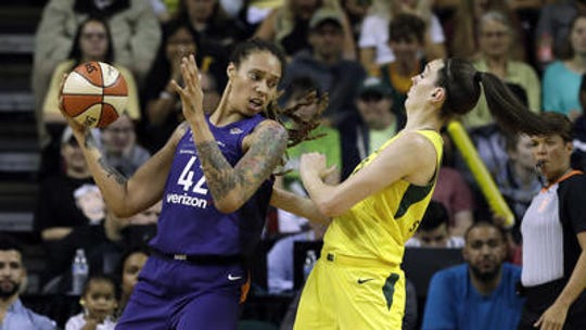 Seattle's Breanna Stewart, right, suffered a serious leg injury Sunday playing against the Mercury's Brittney Griner (42) in the EuroLeague final. The two met last summer in the 2018 WNBA playoff semifinals.