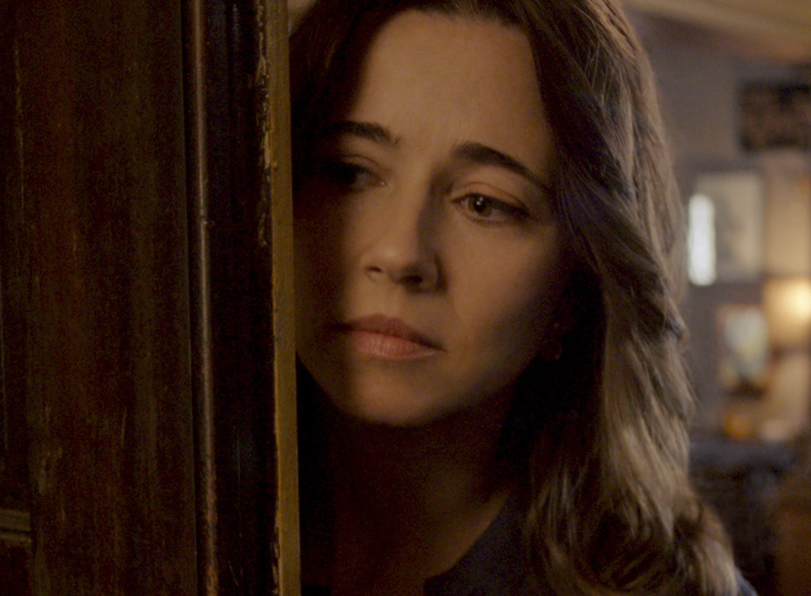 "Anna (Linda Cardellini) peeks out in ""The Curse of La Llorona."""
