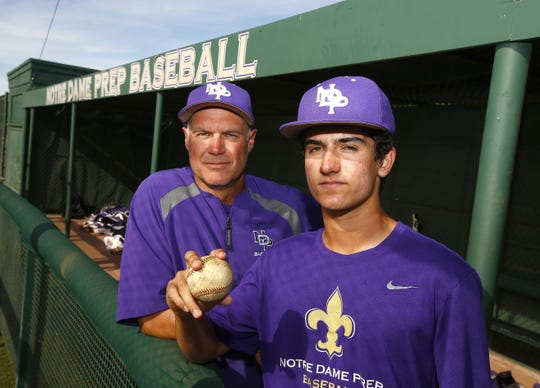 Notre Dame Prep sophomore Brady Fischer poses for a portrait with his father and varsity baseball coach Brian Fischer at Notre Dame Prep Baseball Field in Scottsdale, Ariz. on April 8, 2019.