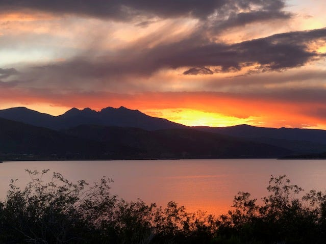 A colorful sunset behind Four Peaks over Roosevelt Lake.