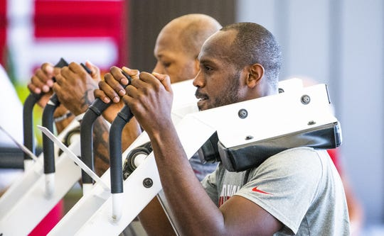 Chandler Jones and Terrell Suggs get to work at the Cardinals' offseason strength and conditioning program on April 9.