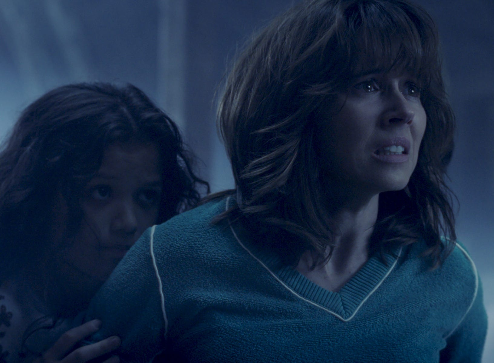 "Anna (Linda Cardellini) protects Samantha (Jaynee-Lynne Kinchen) in ""The Curse of La Llorona."""