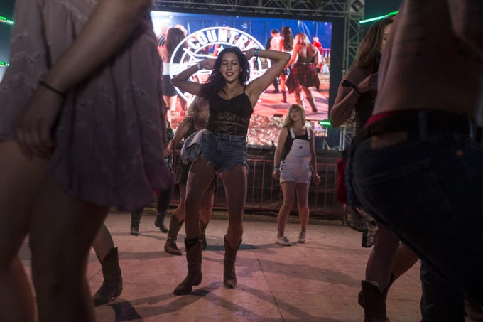 Alexis Osuna dances on Sunday, April 14, 2019, during Day 4 of Country Thunder Arizona in Florence, Ariz.
