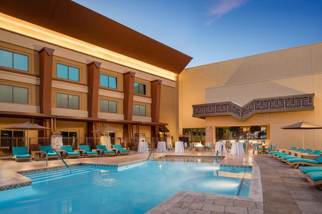 Relax poolside without any resort fees at Vee Quiva.