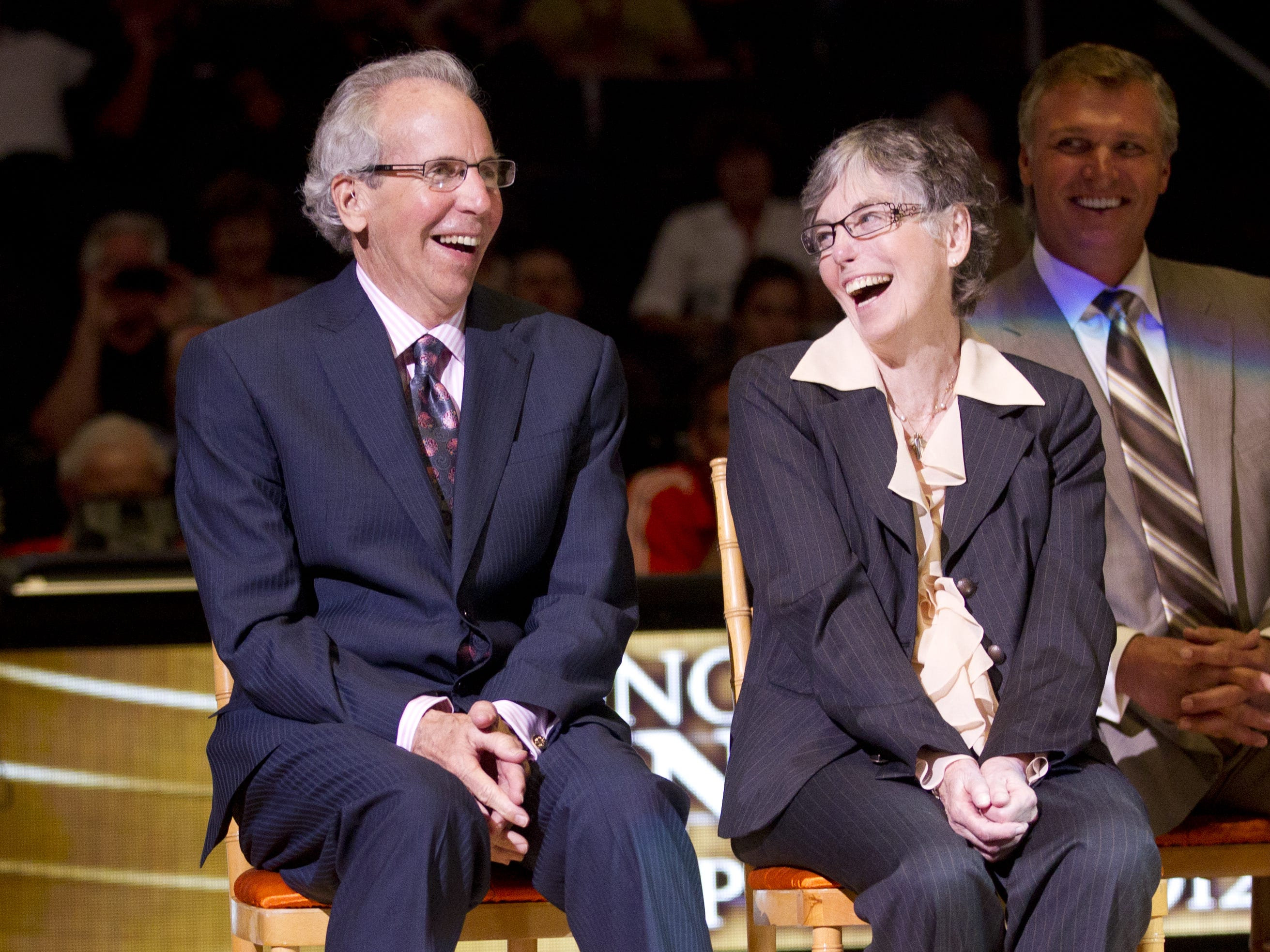 Former Suns head coach John MacLeod and his wife, Carol, laugh during halftime induction ceremonies to the team's Ring of Honor in 2012.
