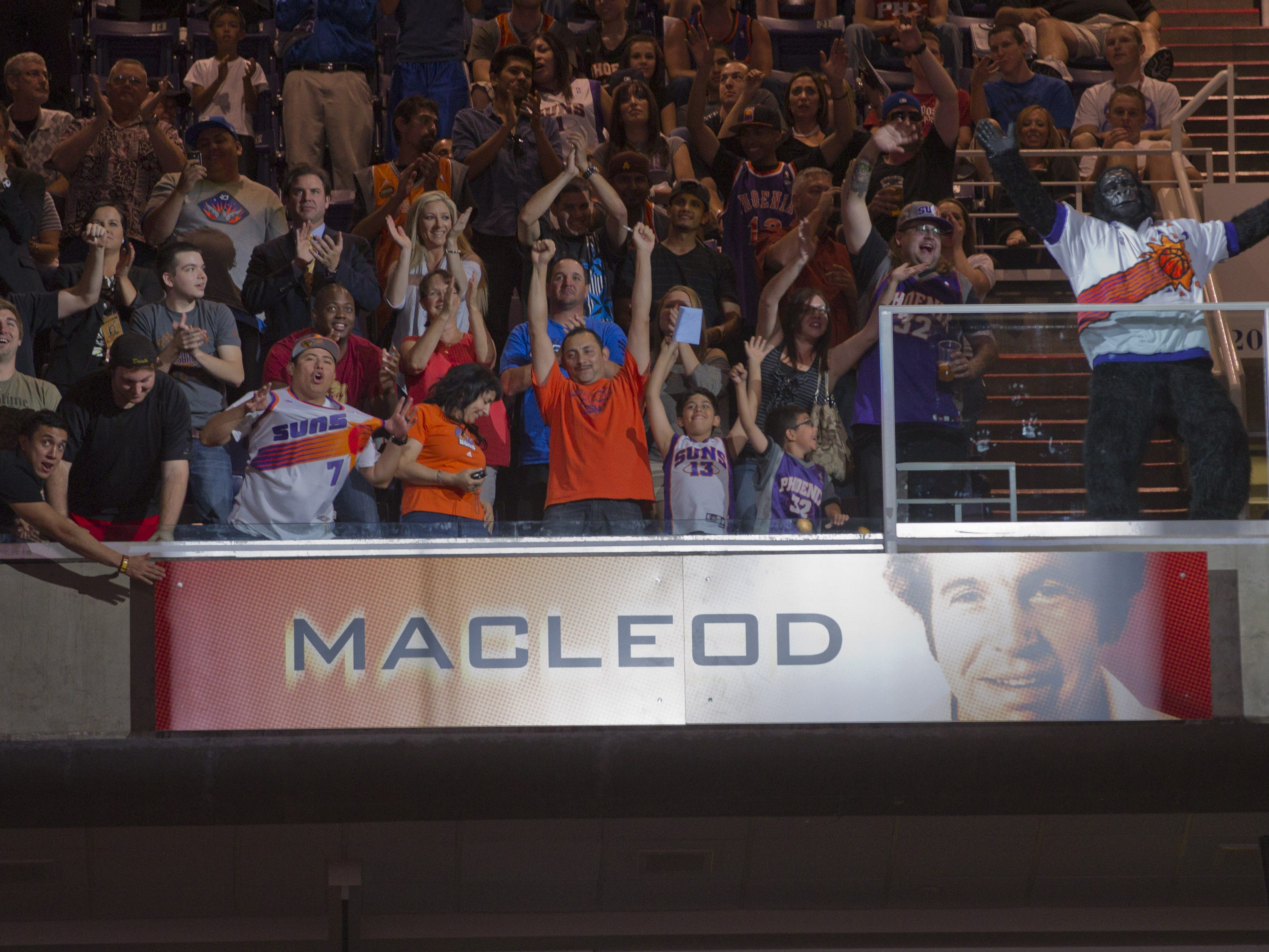 A banner is revealed for former Suns head coach John MacLeod during halftime induction ceremonies to the team's Ring of Honor in 2012.