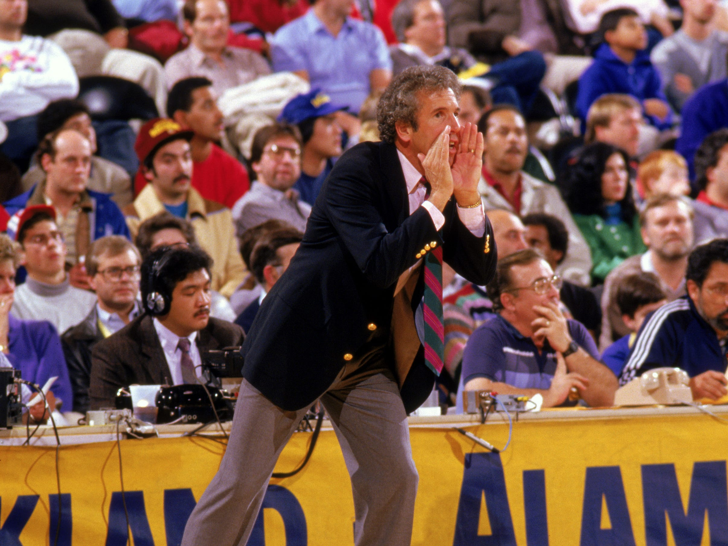 Suns head coach John MacLeod yells to his players against the Golden State Warriors at the Oakland Coliseum in Oakland, California, in 1988.