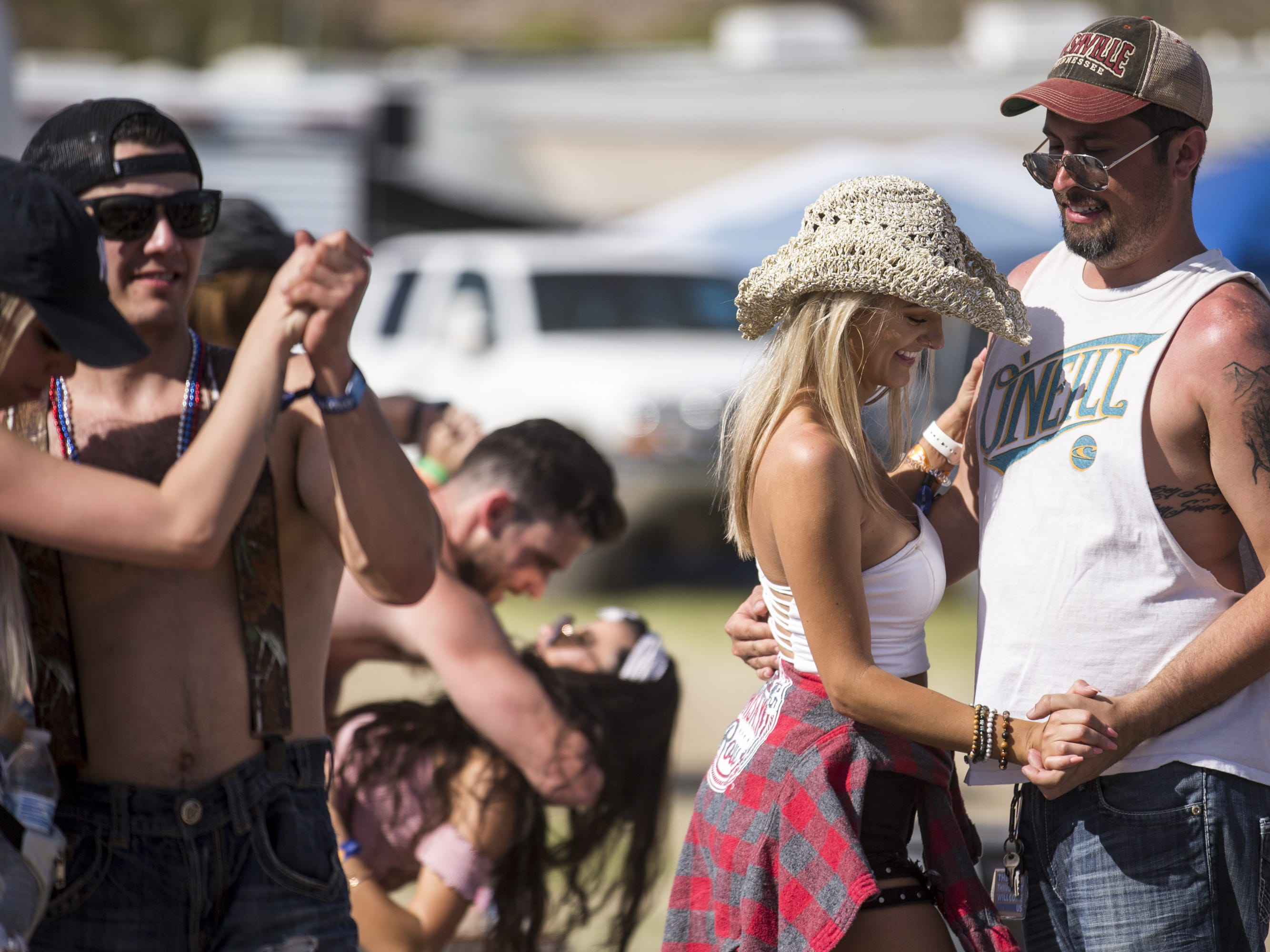 Festival-goers dance at the Crazy Coyote campground on Sunday, April 14, 2019, during Day 4 of Country Thunder Arizona in Florence, Ariz.