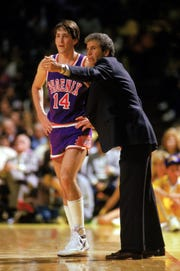 Suns coach John MacLeod talks with Jeff Hornacek during a game against the Lakers in 1987.