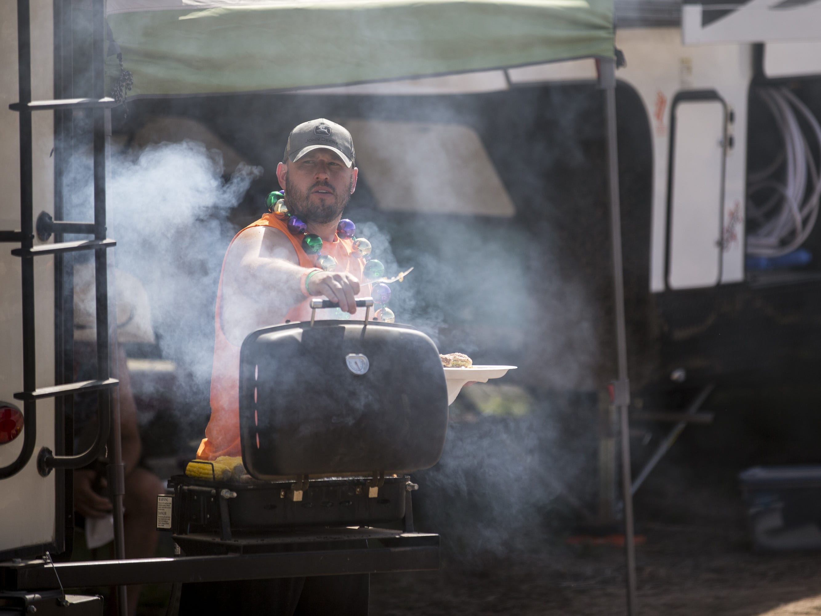 Nick S. grills at his campsite on Sunday, April 14, 2019, during Day 4 of Country Thunder Arizona in Florence, Ariz.