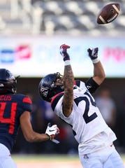 Safety Rhedi Short steps in front of receiver Thomas Marcus Jr. to deflect the ball away and foil the pass play for the Arizona Wildcats' spring game on Saturday.