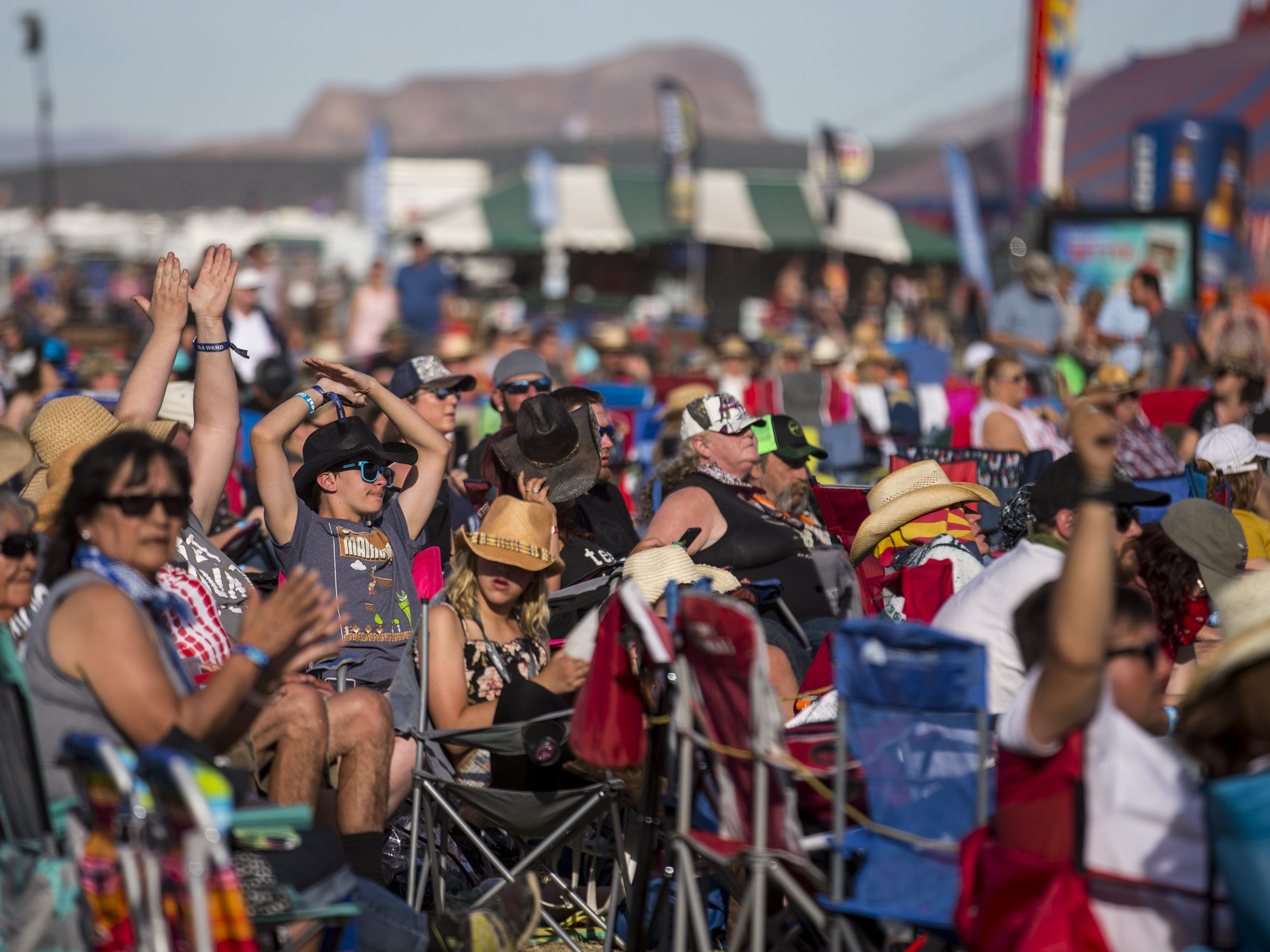 Festival-goers watch Restless Heart perform on Sunday, April 14, 2019, during Day 4 of Country Thunder Arizona in Florence, Ariz.