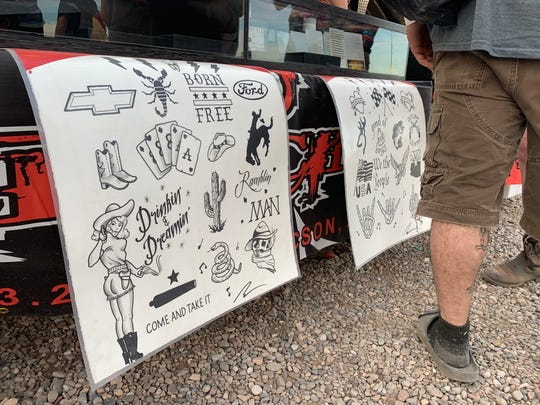 Those who got tattoos at the festival mostly chose their designs from these signs posted at the front of the tent.