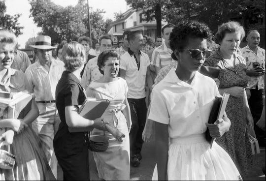 Hecklers, including Hazel Bryan, jeering at center, follow Elizabeth Eckford as she walks away from Little Rock's Central High School September 4, 1957.