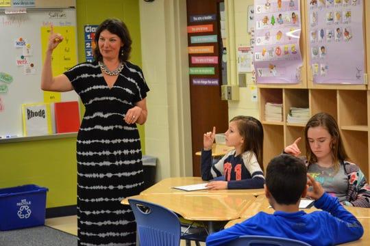 Students practice the sign language alphabet with speech therapist Jen Nickel.