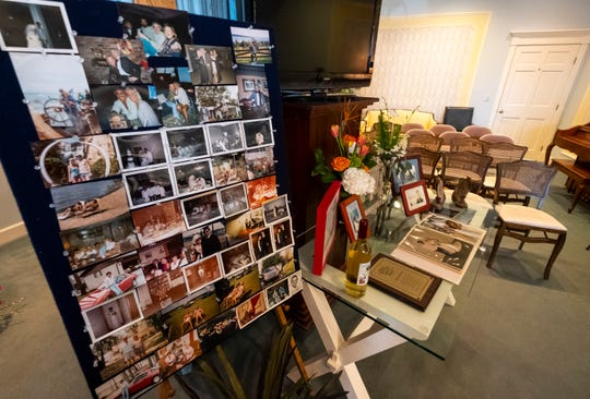 Photographs and other items are displayed in memory of Rock Stevens during funeral services Monday, April 15, 2019 at Marysville Funeral Home.