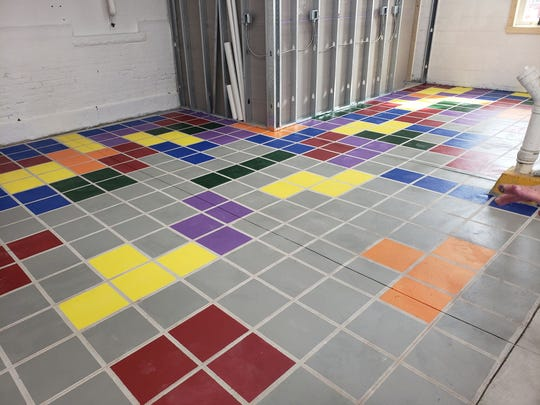 "Volunteers supporting the River Rec Teen Zone painted a mural in the building based off the classic video game ""Tetris."""