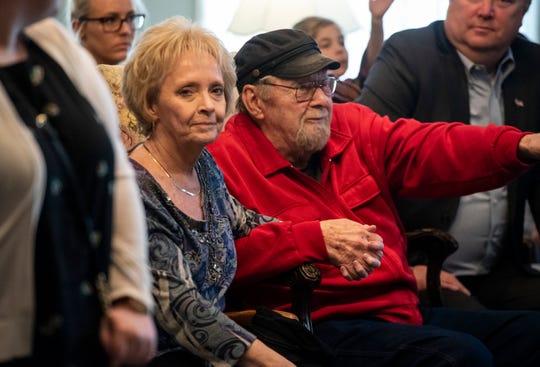 "Gayle Stevens, left, wife of Rock Stevens, holds hands with Rock's father Alton ""Big Al"" Stevens after his funeral services Monday, April 15, 2019 at Marysville Funeral Home."