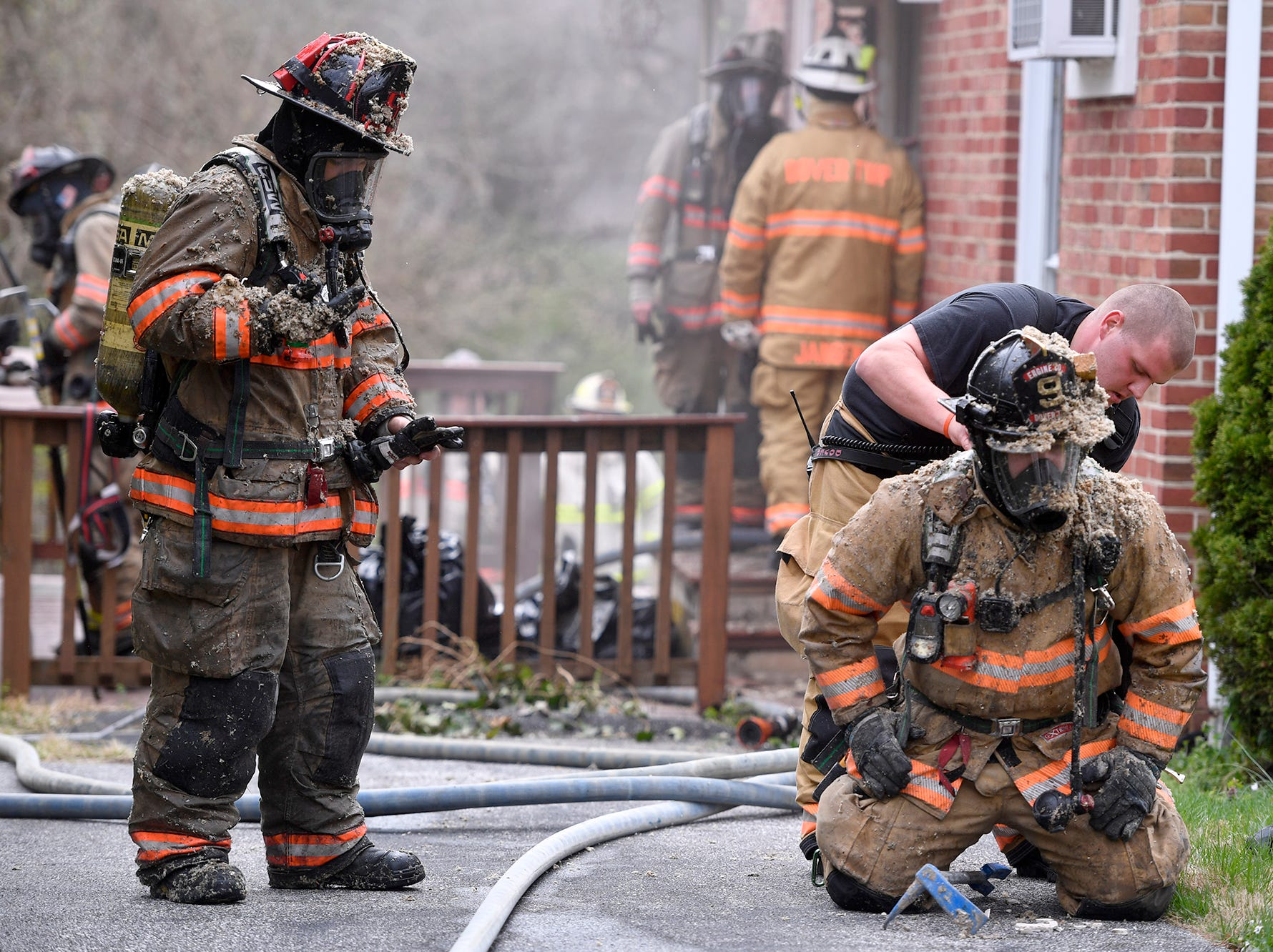 Firefighters battle a blaze in a vacant single family home in the 200 block of North Williams Street in West Manchester Township, Monday, April 15, 2019.