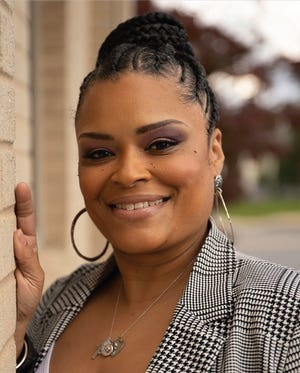 """Monica Williams, 47, of West Manchester Township, recently published a book called """"How I loved GOD and Her: The Battle of the Heart,"""" about her journey of reconciling her Christian faith with her same-sex relationship."""