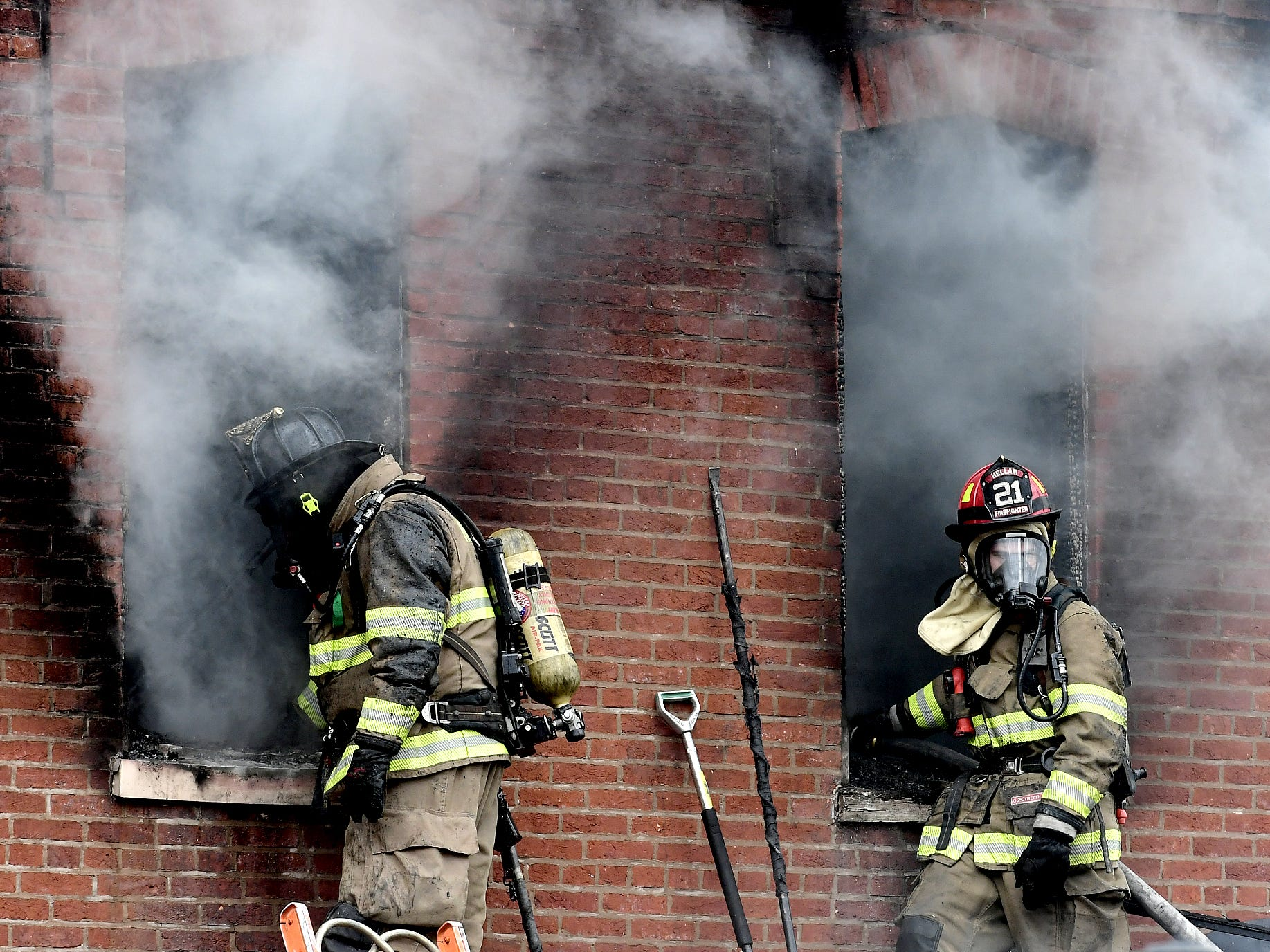 Firefighters battle a blaze at a house in the 200 block of Walnut Street in Wrightsville Monday, April 15, 2019. At about 12:50 p.m., firefighters inside the burning building were ordered via radio transmissions to evacuate immediately. Bill Kalina photo